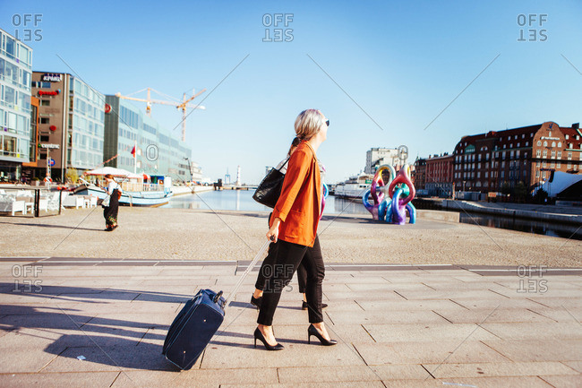 Young business women with luggage in Malmo, Sweden