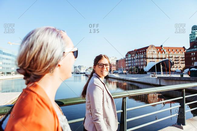 Young women crossing a bridge in Malmo, Sweden