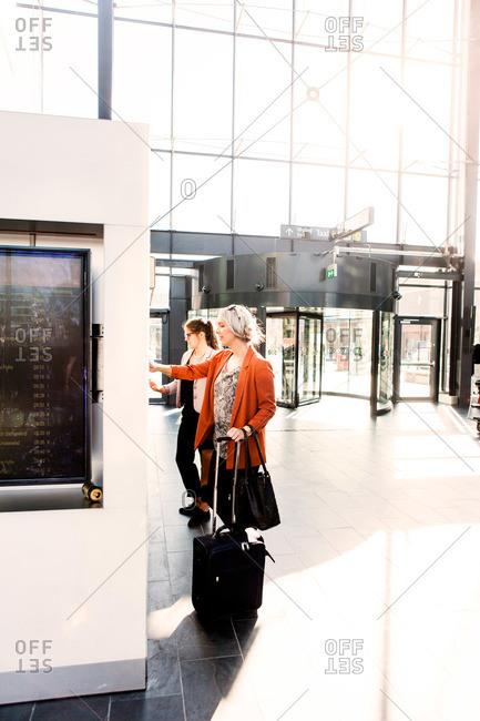 Women purchasing train tickets in Malmo, Sweden