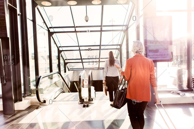 Business women using escalator in Malmo Central Station in Sweden