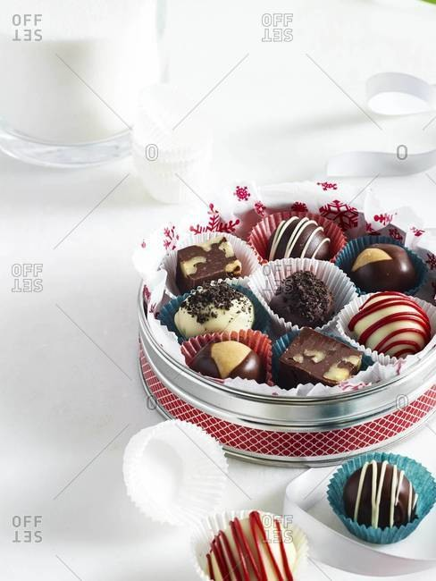 Chocolate candies in a holiday tin