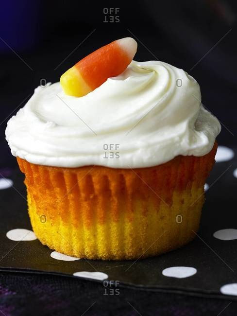 Candy corn cupcake with white frosting