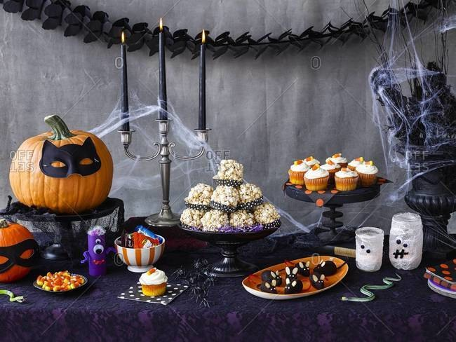 Sweets on a decorated Halloween party table