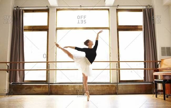 Ballet dancer rehearsing in studio