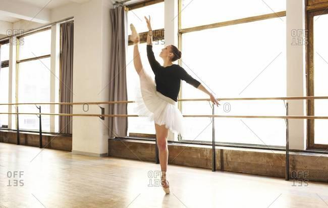 Graceful ballerina dancing in studio