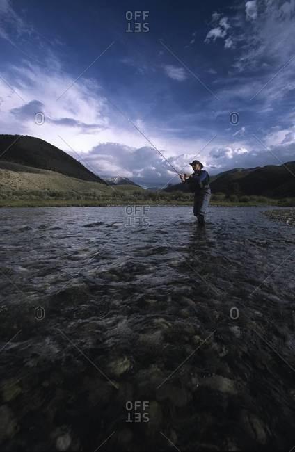 Fisherman casting in river