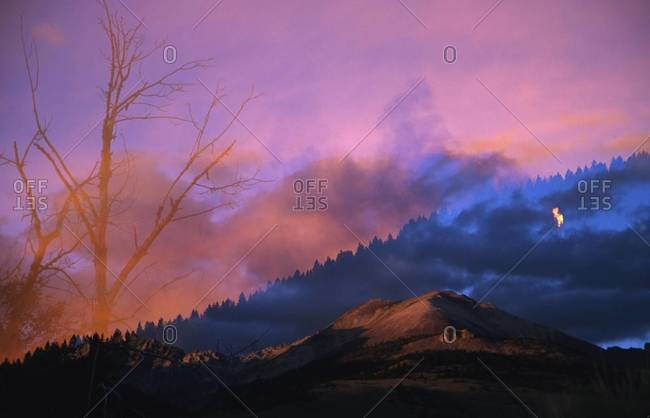 Double exposure of mountains and wildfire