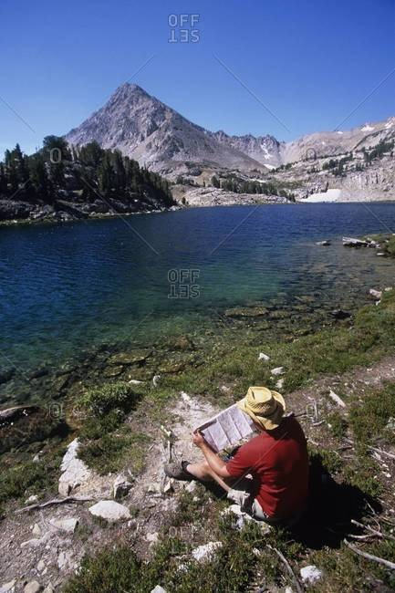 Map reading at Cove Lake in the White Cloud Mountains, Sawtooth National Recreation Area, Idaho