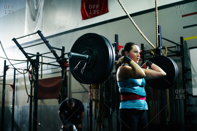 Woman power lifting at a gym