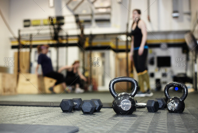 Different types of hand weights at a gym