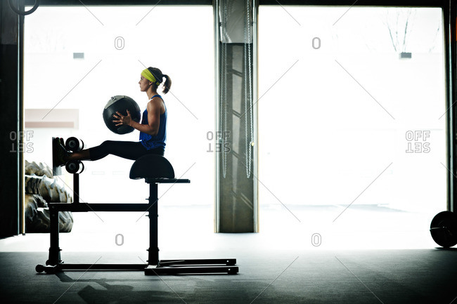Woman doing abs exercises at a gym