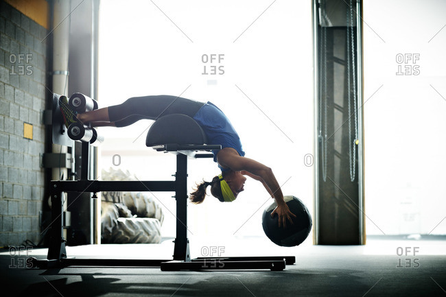 Woman doing crossfit training with a weighted ball