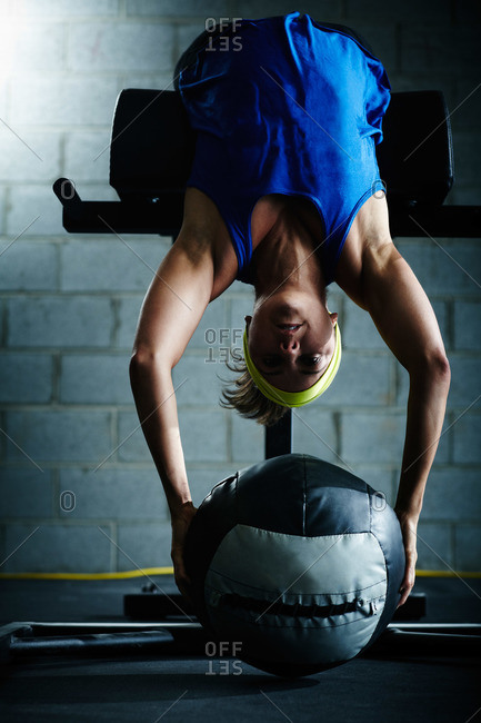 Woman crossfit training with a weighted ball