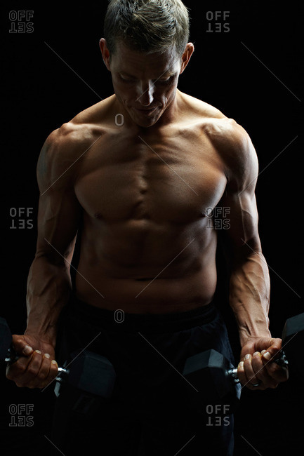 Muscular man with hand weights