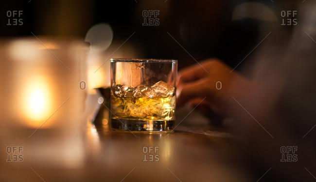 A drink on the rocks at a bar
