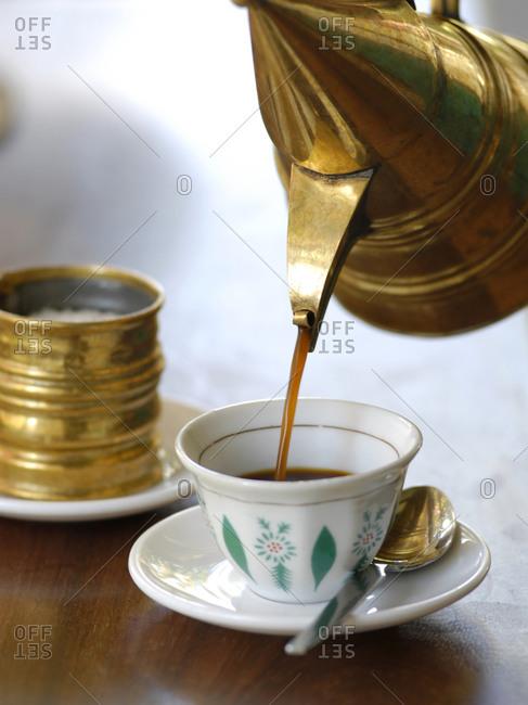 Coffee being poured in Kijani house hotel in Shela, Lamu island, Kenya