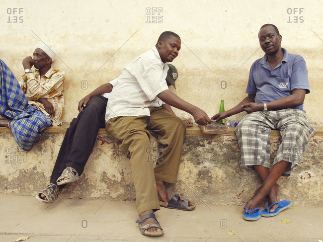 Lamu island, Kenya - March 30, 2007: Men playing a game in Lamu village