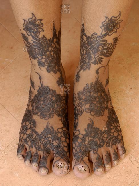 Shela village, Lamu island, Kenya - Woman's feet during a henna ceremony