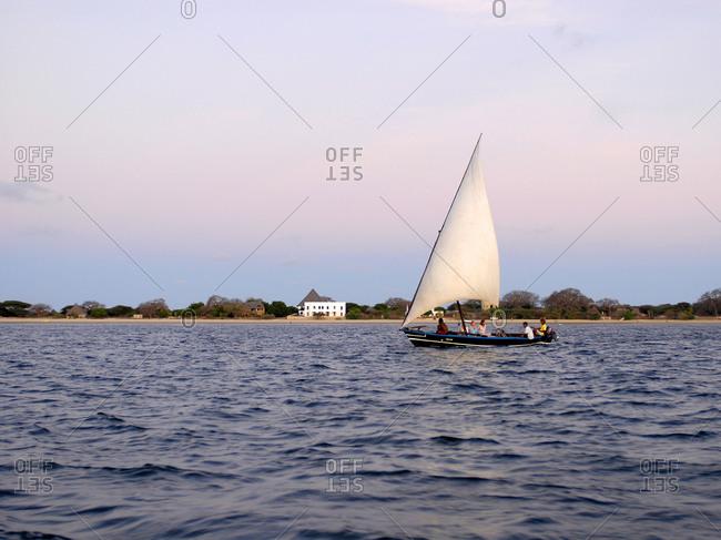 Lamu island, Kenya -  Tourists on a dhow sailing boat
