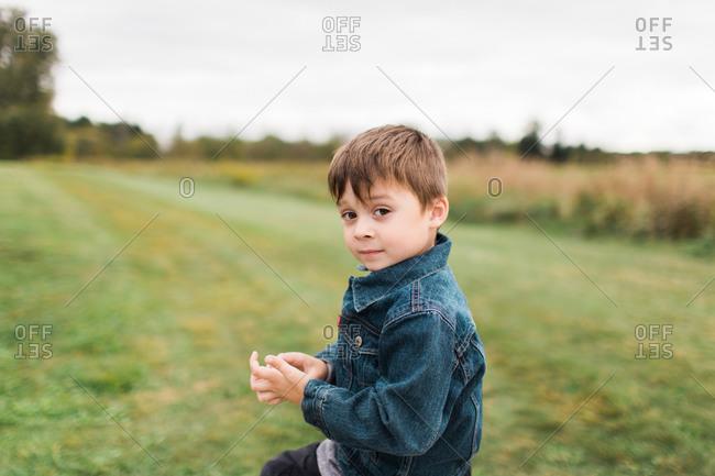 Little boy in jean jacket outside