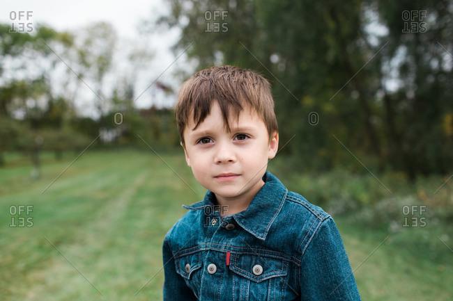 Little boy outside in denim jacket