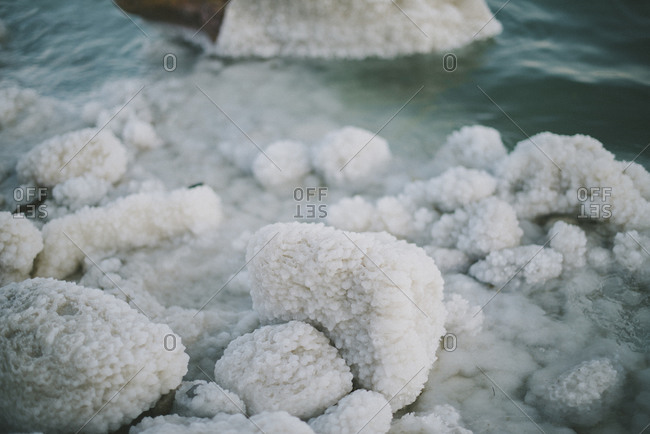 Halite crystals coating rocks on the shores of the Dead Sea