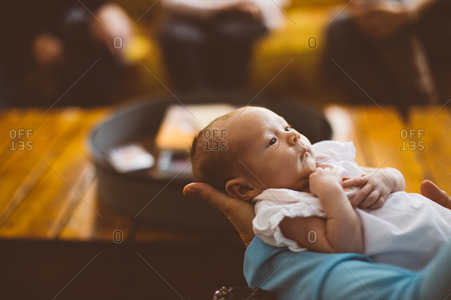 A woman holds a tiny baby