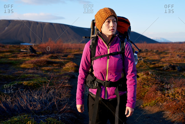 Young Asian woman hiking while on vacation in Iceland