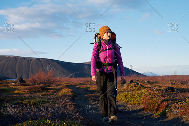Asian woman hiking while on vacation in Iceland
