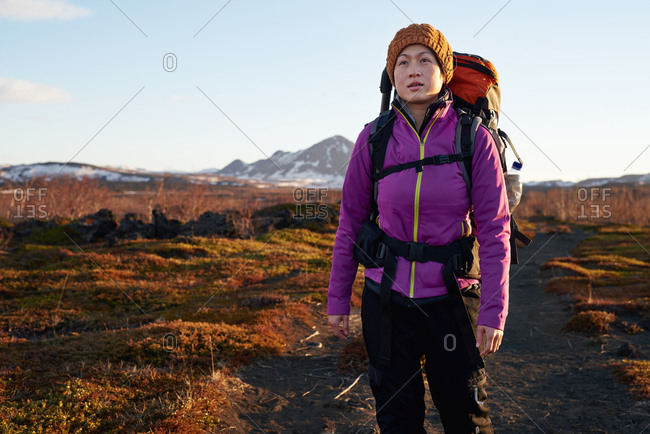 Woman hiking while on vacation in Iceland
