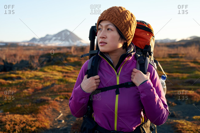 Portrait of a young woman hiking while on vacation in Iceland