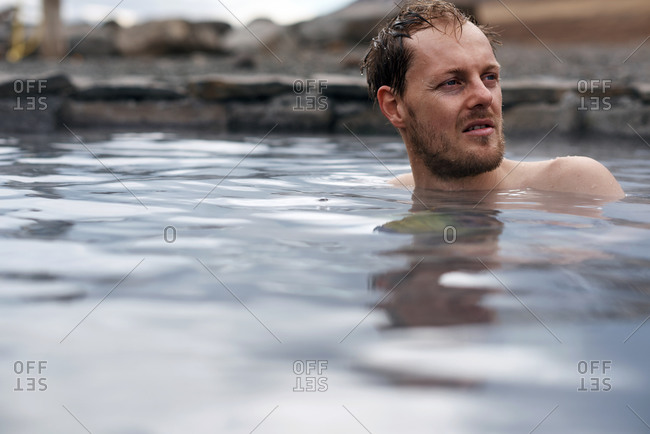 Tourist in a natural hot spring in Iceland