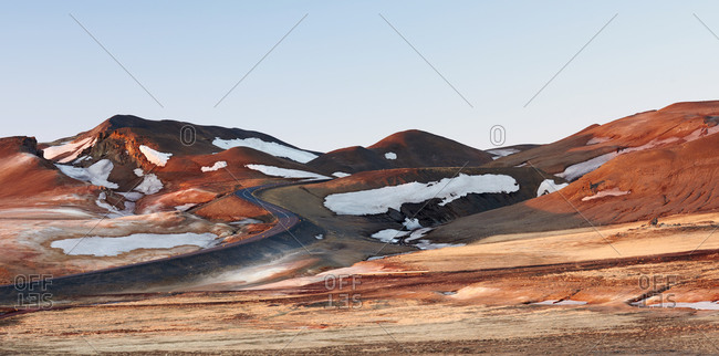 Orange landscape with road and snow in Iceland