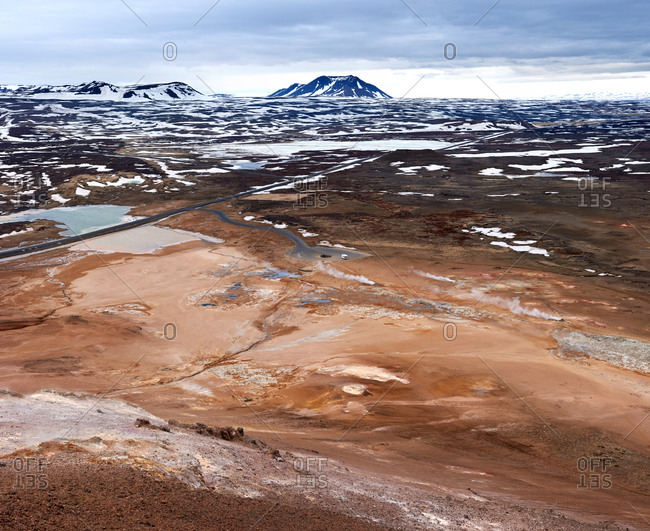 Motorhome and road in harsh volcanic landscape in Iceland