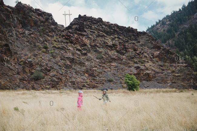 Girls exploring a mountain prairie