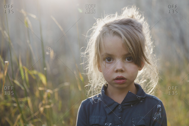 Portrait of girl in birch forest