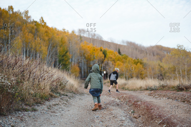 Boy and girl on dirt road in rural hills