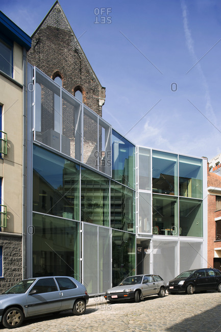 Ghent, Belgium June 6, 2007: Modern office building with glass front and remnants of old chapel
