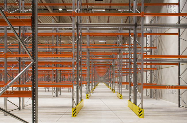 Aisle in warehouse of empty shelves