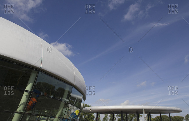 Kruibeke, Belgium - September 8, 2008: Convex edge of service station exterior with disk shaped covered area
