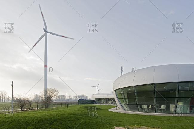 Kruibeke, Belgium - December 3, 2008: Modern energy efficient curved building in the Belgian countryside