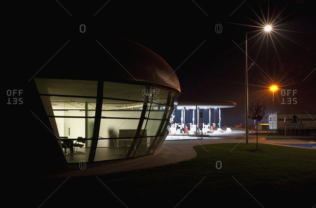 Kruibeke, Belgium - December 7, 2008: Exterior of meeting room and covered fuel pump area at Belgian service station at night