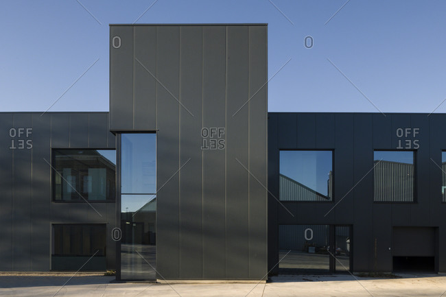 Ghent, Belgium - December 11, 2013: Exterior front view of a modern office building with reflective windows