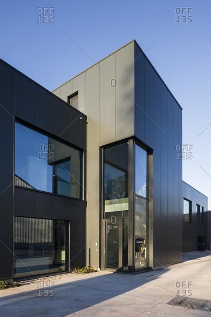 Ghent, Belgium - December 11, 2013: Protruding rectangular entrance to a modern office building