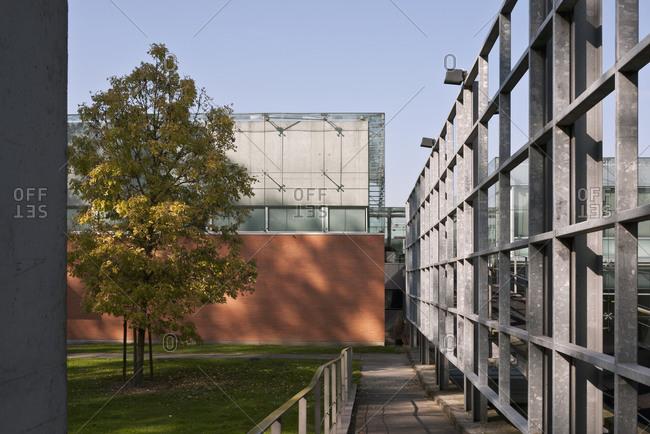 Ghent, Belgium - October 3, 2011: Metal grid frame along walkway in courtyard of office building