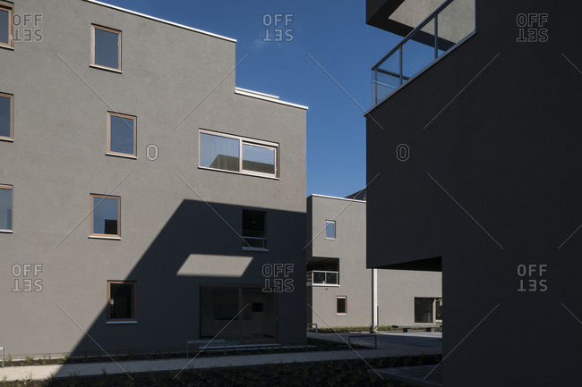 Exterior of contemporary apartment building from courtyard