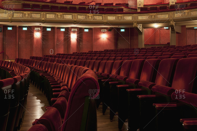 Ghent, Belgium - December 13, 2011: Rows of red velvet seats in an ornate theater