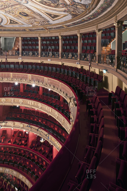 Ghent, Belgium - December 13, 2011: Audience seating and ceiling painting from top level in Opera Ghent