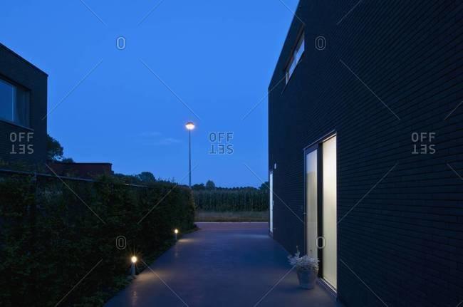 Walkway lights outside modern house in evening