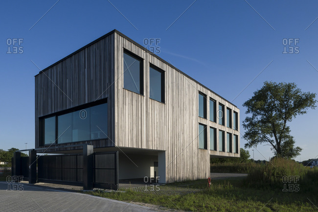 Ghent, Belgium - July 30, 2014: Modern office building with parking beneath